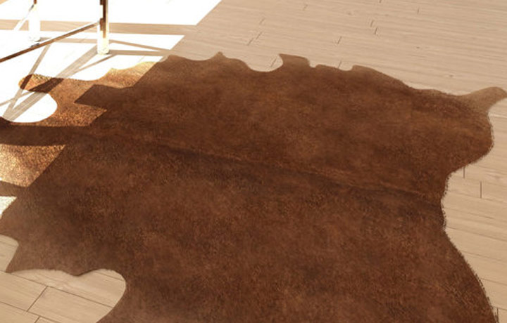 How do we clean a Cowhide Rug?